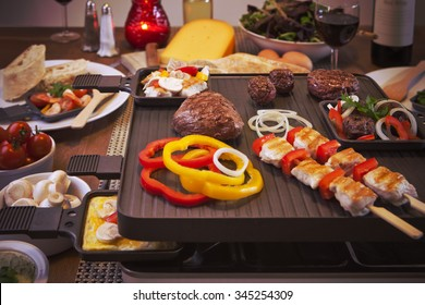 Swiss raclette or the Dutch variant 'gourmetten'. A table filled with ingredients for a dish that is usually served on celebratory evenings like Christmas or New Years Eve in The Netherlands.
