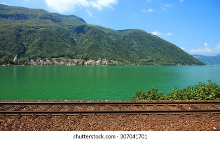Swiss railroad near lake, Europe.