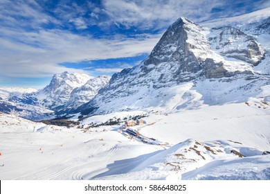 Swiss ski Alpine mountain resort with famous Eiger, Monch and Jungfrau mountain, Grindelwald, Berner Oberland, Grindelwald, Switzerland.