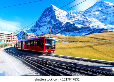 Swiss train at Kleine Scheidegg station in Jungfrau area.OCT 18, 2016: View of a Jungfrau Railways train, connecting Kleine Scheidegg to Jungfraujoch. Switzerland.