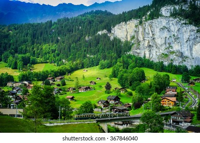 The swiss train with village and mountain landscape in Switzerland