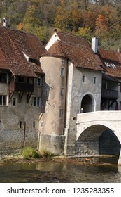 In the Swiss village of Saint-Ursanne, the main stone bridge on the Doubs river and the entrance tower