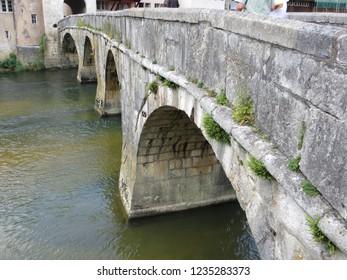 In the Swiss village of Saint-Ursanne, the main stone bridge on the Doubs river