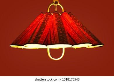 Switced on red ceiling lamp, isolated on red.