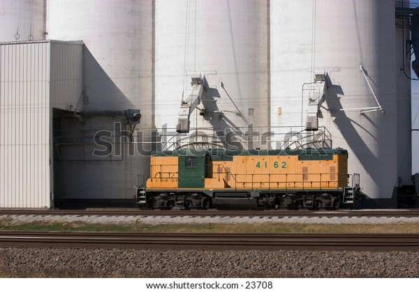 Switch engine beside Nebraska grain elevator