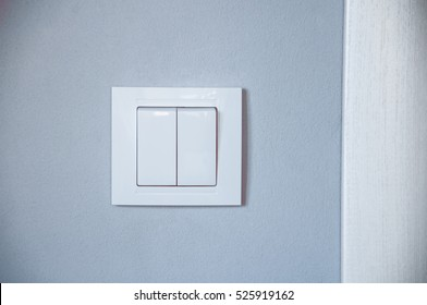 switch on a gray wall