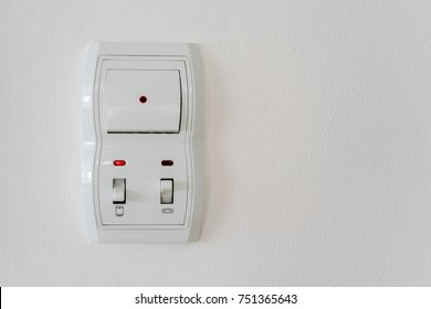 Switch on the white wall