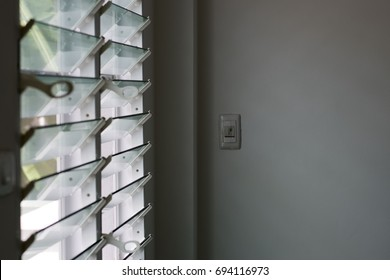 switch in the room with louver window