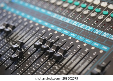 switch, sound controller, mixer board, Buttons and tabs in various parts of the audio controller mixer ,music,studio,audio sound with buttons and sliders