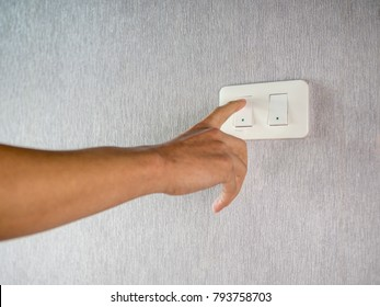 Switching on off light switcher on wall