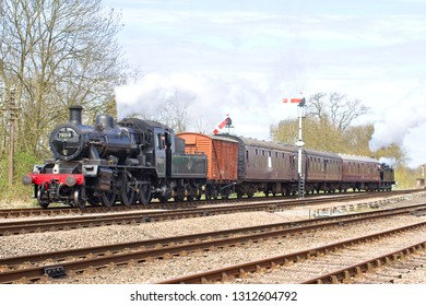 SWITHLAND, LEICESTERSHIRE, UK - APRIL 28, 2013: LMS Ivatt Class 2 Mogul No. 78019 brings up the rear of the 2B11 12:00 Leicester North to Loughborough service, passing Swithland Sidings.