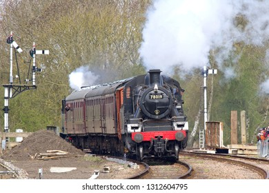 SWITHLAND, LEICESTERSHIRE, UK - APRIL 28, 2013: LMS Ivatt Class 2 Mogul No. 78019 leads the Loughborough to Leicester North service through Swithland Sidings, with LNWR Webb Coal Tank at the rear.