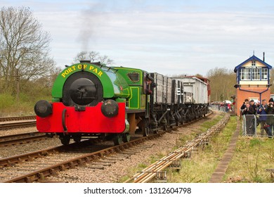SWITHLAND, LEICESTERSHIRE, UK - APRIL 28, 2013: When compared against the attached Mountsorrel Granite mineral wagon, the low height of Bagnall 0-4-0ST No. 2572 'Judy' can be better under understood.