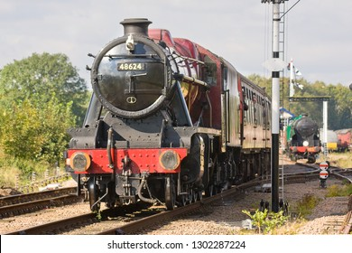 SWITHLAND, LEICESTERSHIRE, UK - OCTOBER 6, 2012: Steam locomotive LMS Stanier 8F 2-8-0 No. 48624 hauls a Leicester North bound passenger train through Swithland Sidings during the GCR's Autumn Gala.