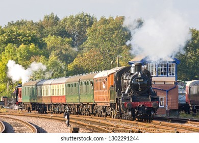 SWITHLAND, LEICESTERSHIRE, UK - OCTOBER 6, 2012: LMS Ivatt Class 2 Mogul No. 78019 heads through Swithland Sidings with a passenger service for Leicester North during the GCR's Autumn Gala.