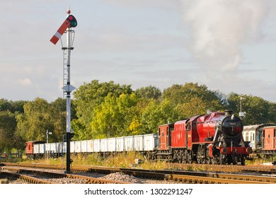 SWITHLAND, LEICESTERSHIRE, UK - OCTOBER 6, 2012: Steam locomotive LMS Stanier 8F 2-8-0 No. 48624 hauls a minerals freight train through Swithland Sidings during the GCR's Autumn Gala.
