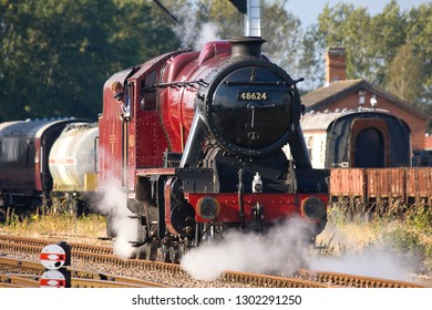 SWITHLAND, LEICESTERSHIRE, UK - OCTOBER 6, 2012: Steam locomotive LMS Stanier 8F 2-8-0 No. 48624 carries out a positioning move at Swithland Sidings on the Great Central Railway during the Autumn Gala