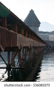 Switzerland, 08/12/2016: view of the famous Water Tower and the Chapel Bridge, the covered wooden footbridge built in 1333 and spanning across the Reuss River in the medieval city of Lucerne