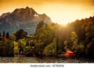 Switzerland Alps Sunrise on Lucerne Lake with Mount Pilatus in the background.