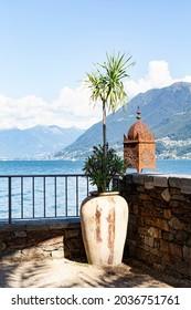 Switzerland, Ascona, 1 Sept 20. Idyllic lookout on the isle of Brissago with vase and lantern