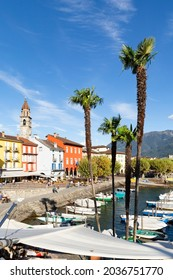 Switzerland, Ascona, 1 Sept 20. View on the waterfront with colorful buildings and palm trees
