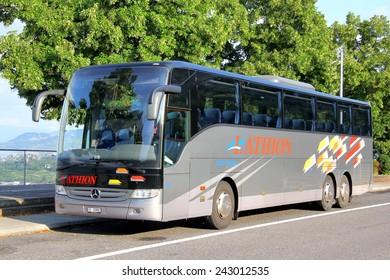 SWITZERLAND - AUGUST 5, 2014: Touristic coach Mercedes-Benz O350-16RHD Tourismo at the interurban freeway.