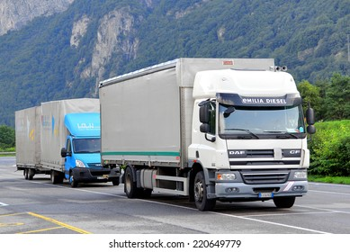 SWITZERLAND - AUGUST 5, 2014: White cargo truck DAF CF at the high Alpine mountain road.
