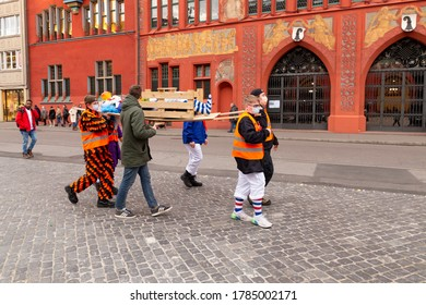 Switzerland, Basel, March 3rd 2020. Symbolic burial of the basel carnival cancelled due to corona virus pandemic in front of the red town hall building
