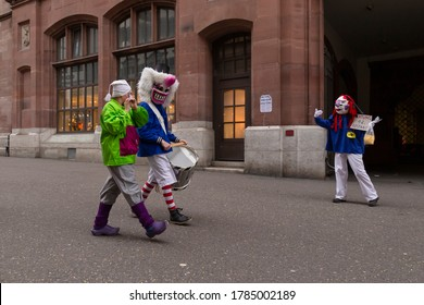 Switzerland, Basel, March 3rd 2020. Basel carnival cancelled due to corona virus pandemic. Small group of participants parading through the otherwise empty street simulating social distancing