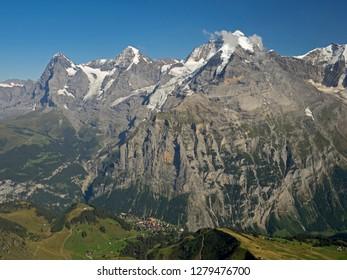 Switzerland, Bern Canton, Birg gondola station, view of Eiger, Monk, and Jungfrau, with Murren