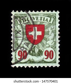 SWITZERLAND - CIRCA 1924: A stamp printed by Switzerland, shows red cross, coat of arms of Switzerland, circa 1924.