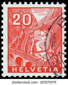 SWITZERLAND - CIRCA 1934: A stamp printed in Switzerland shows train track to Railway St Gothard, circa 1934