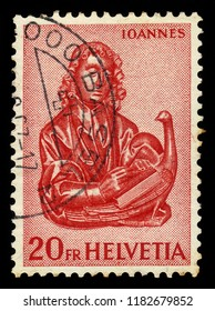 SWITZERLAND - CIRCA 1961: stamp printed by Switzerland, shows wood carvings of the Evangelist John with the eagle, circa 1961