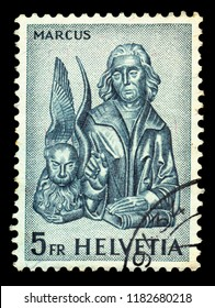 SWITZERLAND - CIRCA 1961: stamp printed by Switzerland, shows wood carvings of the Evangelist Marcus - Saint Mark with the lion, circa 1961