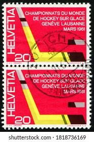 SWITZERLAND - CIRCA 1961: stamp printed by Switzerland shows Ice Hockey Stick and Puck, International Ice Hockey Championships, Lausanne and Geneva, circa 1961