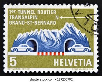 SWITZERLAND - CIRCA 1964: A stamp printed in Switzerland shows a Road Tunnel Through Great St. Bernard, circa 1964