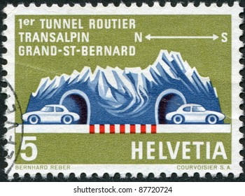 SWITZERLAND - CIRCA 1964: A stamp printed in Switzerland, shows a Road Tunnel Through Great St. Bernard, circa 1964