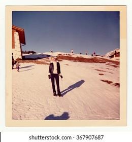 SWITZERLAND, CIRCA 1970s: Vintage photo shows woman on winter vacation, circa 1970s.