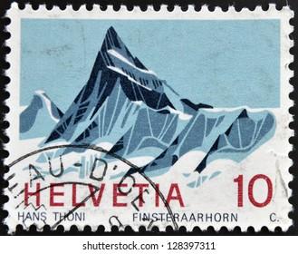 SWITZERLAND - CIRCA 1980: A stamp printed in Switzerland shows Finsteraarhorn, Bernese Alps, circa 1980