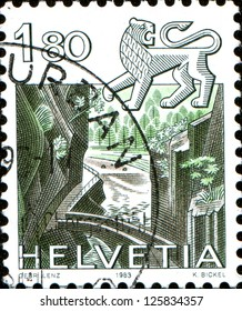 SWITZERLAND - CIRCA 1983: A stamp printed Switzerland, officially Confideratio Helvetica, shows Zodiac sign Lion on the background of Areuse Gorge, circa 1983