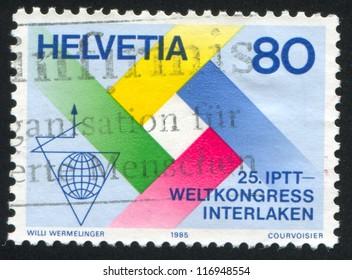 SWITZERLAND - CIRCA 1985: stamp printed by Switzerland, shows Emblem of Postal, Telegraph and Telephone Congress, Interlaken, circa 1985