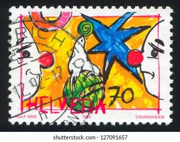 SWITZERLAND - CIRCA 1992: stamp printed by Switzerland, shows Sea lion and clowns, circa 1992