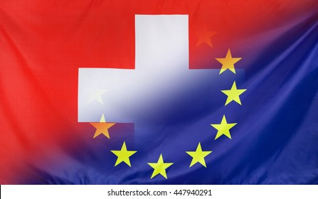 Switzerland and European Union relations concept with diagonally merged real fabric flags