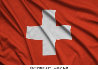 Switzerland flag  is depicted on a sports cloth fabric with many folds. Sport team banner