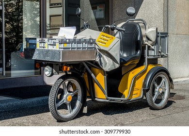 Switzerland, Geneva - June 2015. Swiss post delivery motorcycle on the street in the city center of Geneva. Swiss post is a public company owned by the Swiss Confederation