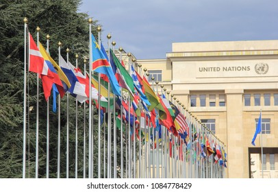 Switzerland; Geneva; March 9, 2018; Two rows of the United Nations member states flags with the United Nations Office in Geneva in the background;