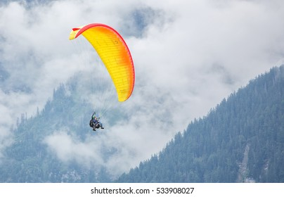 SWITZERLAND. INTERLAKEN - JUNE 22, 2013. SUNDAY PARAGLIDING FLIGHT AMONGST SWISS ALPS IN INTERLAKEN