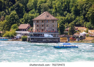 Switzerland – Jul 4, 2017: Touristic boat at rhein river as seen from Neuhausen am Rheinfall .Boat  can be taken up to the falls, with a spectacular view of the falls built on both sides of the Rhine.