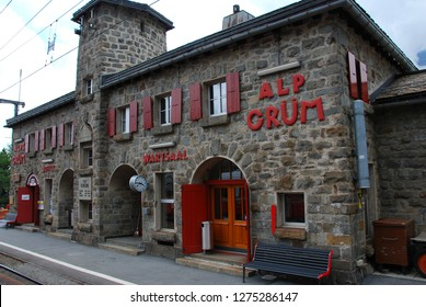 Switzerland, July 2012: Alp Grum Station of famous red alpine train Bernina Express in Switzerland.