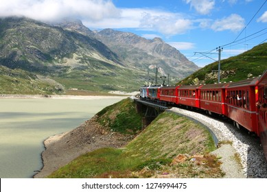 Switzerland: July 2012, Famous red alpine train Bernina Express (from St.Moritz to Tirano) near Bernina Pass (Switzerland)